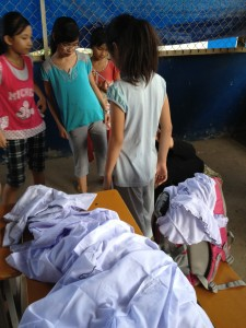 Distribution new school uniforms for children of House #3 & 4